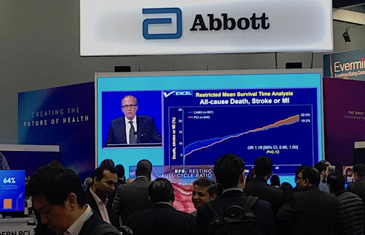 People watch the presentation of the five-year EXCEL Trial data by Gregg Stone, M.D., live in the Abbott booth at TCT 2019. Abbott makes the Xience stent used in the trial, which compared equally with long term surgical outcomes. #TCT2019