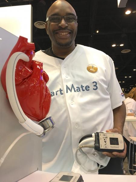 A patient who received the HeartMate III LVAD system showing off his external battery pack. He served as a patient ambassador in the Abbott booth at ACC 2018. The HeartMate III, with its magnetic levitated pump, showed a big reduction in clotting over previous LVADs in a key late-breaking trial at ACC earlier this year.