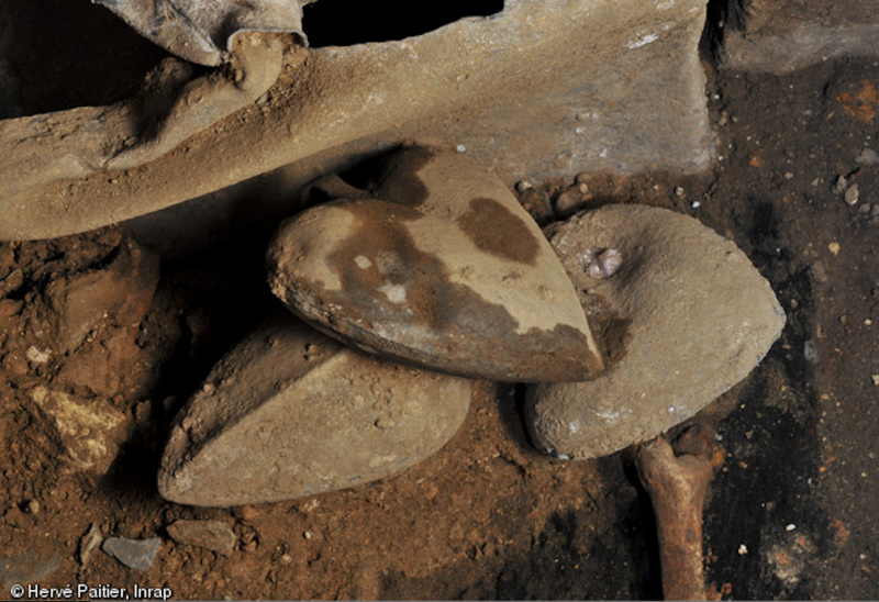 Lead heart-shaped lead urns contained the hearts of knights. Image by Rozenn Colleter, Ph.D., INRAP.