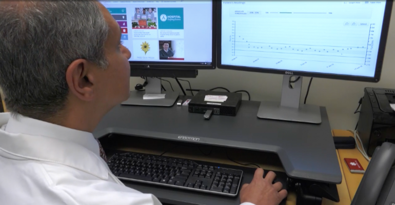 William Abraham monitoring a heart failure patient's chest fluid buildup with remote monitoring using the SensiVest
