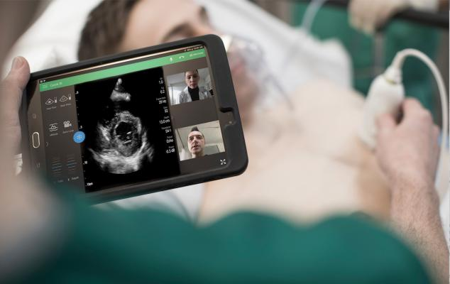 The Philips Lumify point-of-care ultrasound (POCUS) system assessing a patient in the emergency room combined with telehealth to enable real-time collaboration with other physicians.