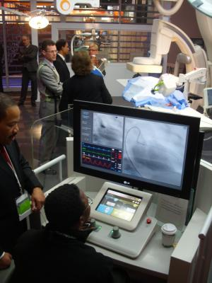 The Corindus CorPath robotic navigation system, which helps guide cath lab procedures without the need for operators to wear lead aprons, was a centerpiece technology in a hybrid OR display created by Philips Healthcare.