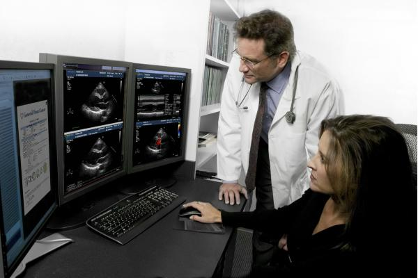 The Novarad CardioReport echo reporting system. The right screen shows the cardiac ultrasound images and the report on the left screen.