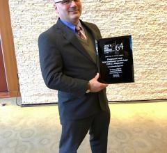 DAIC Editor Dave Fornell displays the 2018 Neal Award for Best Use of Social Media