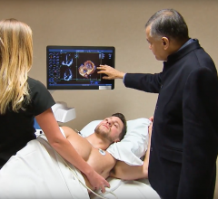 Dr. Bijoy Khandheria, a cardiologist from Aurora Health in Milwaukee, explains a cardiac echo image with a patient.