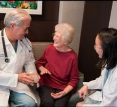 Patient Lillian Keavey speaks with Henry Ford cardiologists William O'Neill and Dee Dee Wang about her case. She was the 1,000th patients at Henry Ford to have their procedure guided by 3-D print.