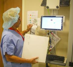 RFID inventory management system in use scanning in cath lab supplies using a Cardinal Health system