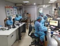 While it looks like the inside of a hospital, these are actually bank tellers in full personal protective equipment (PPE) in Bangladesh in early March 2020. There was widespread fear the virus would quickly spread across this poor country with limited healthcare resources, so many companies too precautions to protect their employees. Photo from Aster Azalea.