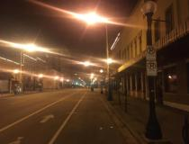 The main street in Champaign, Illinois, on a Saturday night on what should be a busy evening in this larger college town that is home of the University of Illinois. Photo by Daniel Flora.