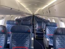 An empty U.S. commercial Delta Airlines flight midweek in late March 2020, when commercial passenger air travel came to sudden halt due to COVID-19 with tens of thousands pf passengers cancelling travel plans many because their meetings, conferences and vacation destinations shut down to aid coronavirus containment efforts. Photo by commercial pilot Andrew Vlack pilot.