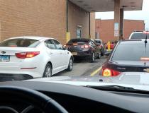 ------ With patients not wanting to stand in line to wait for prescriptions in pharmacies, drive through lines became extremely long across the country, as seen here at a Walgreens in Aurora, Illinois. Photo by David Lasee.