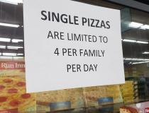A sign noting the limit of frozen pizzas customers can buy at a grocery store in Aurora, Illinois. Photo by David Lasee.