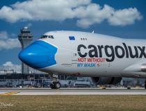 A cargo plane painted to promote mask wearing during the COVID pandemic at O'Hare International Airport in Chicago. Photo by Michael Dziadus