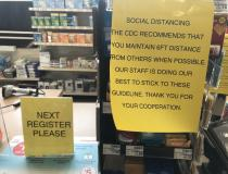 COVID-19 warnings at a CVS pharmacy checkout counter in the Chicago suburbs. Photo by Dave Fornell #coronarvirus #COVID19