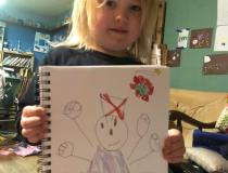 Raynard drew a picture of his mom fighting the COVID-19 virus. His mom is a nursewho isworking at a COVID vaccine clinic administering the shots. Photo by Chaya Margaret Levi-Roth