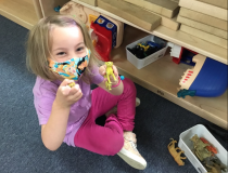 While daycare centers have reopened in most areas after being shut down in some U.S. states due to the COVID outbreak, many have reopened, but with new precautions. Here a 4-year-old in Elgin, Illinois wears a facemask has part of the requirements for attending preschool. Katherine Fornell