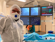 Russian interventional cardiologist Alexey Pankov in full PPE for a cath lab procedure in Moscow.