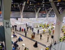 The temporary COVID-19 hospital at the McCormick Place convention center in Chicago being toured by Illinois Gov. J.B. Pritzker April 3. The hospitals beds are set up in at least two of the expo halls, included two used the for annual RSNA radiology meeting in November each year. Photo by Susan Blair, U.S. Army Corps of Engineers, Chicago District