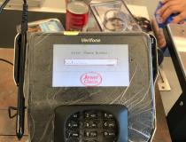 Plastic wrap covering a credit/banking card terminal at a checkout line at a grocery store in the Chicago suburbs. The wrap was added to machines at most stores in an effort to make decontamination of the machines easier. #COVID19