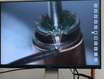 Soldering the impeller motor connections under a microscope. Impella being made at the Abiomed factory.