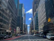 An empty New York City street in Manhattan during the middle of a workweek day. Fear of COVID-19 drove millions or residents to abided by shelter-in-place and work-from-home orders in New York in an effort to contain the virus. The largest city in the United States became a ghost town within a short period. Photo by Mike Borchardt.
