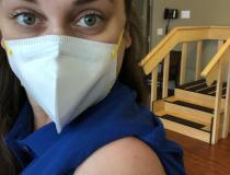 Shannon Yaw, OTR/L, director of rehabilitation at a hard-hit nursing home in Michigan, received her first dose just before Christmas 2020. She had just contracted COVID at work when this image was taken and tested positive a few days later after she developed a dry cough. She has since recovered and returned to work. #COVIDvaccine #COVID19