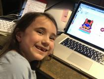First-grader Vivian Fornell, age 6, shows off her new face mask-wearing avatar on her eLearning math program. The program began introducing different styles of face masks children could purchase for their avatar characters this summer with points they earn for completing math problems correctly. Electronic learning via web connections on home computers has become a normal part of life in the COVID era. Photo by Dave Fornell